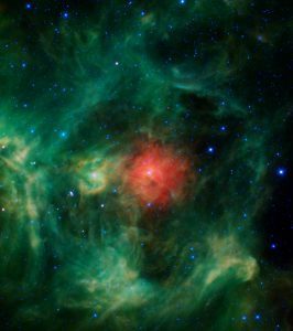 "In keeping with the spirit of the holidays, NASA's Wide-field Infrared Survey Explorer (WISE) mission presents the ""Wreath Nebula"". Though this isn't the nebula's official name (it's actually called Barnard 3 or IRAS Ring G159.6-18.5), it's easy to picture a wreath in these bright green and red dust clouds -- a ring of evergreens donned with a festive red bow, a jaunty sprig of holly, and silver bells throughout. Interstellar clouds like these are stellar nurseries, places where baby stars are being born. The green ring (evergreen) is made of tiny particles of warm dust whose composition is very similar to smog found here on Earth. The red cloud (bow) in the middle is probably made of dust that is more metallic and cooler than the surrounding regions. The bright star in the middle of the red cloud, called HD 278942, is so luminous that it is likely what is causing most of the surrounding ring to glow. In fact its powerful stellar winds are what cleared out the surrounding warm dust and created the ring-shaped feature in the first place. The bright greenish-yellow region left of center (holly) is similar to the ring, though more dense. The bluish-white stars (silver bells) scattered throughout are stars located both in front of, and behind, the nebula. Regions similar to the ""Wreath nebula"" are found near the band of the Milky Way in the night sky. The wreath is slightly off of this band, near the boundary between the constellations of Perseus and Taurus, but at a relatively close distance of only about 1,000 light-years, the cloud is a still part of our Milky Way galaxy. The colors used in this image represent specific wavelengths of infrared light. Blue and cyan (blue-green) represent light emitted at wavelengths of 3.4 and 4.6 microns, which is predominantly from stars. Green and red represent light from 12 and 22 microns, respectively, which is mostly emitted by dust."