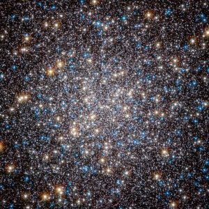 "This image, taken by the Advanced Camera for Surveys on the Hubble Space Telescope, shows the core of the great globular cluster Messier 13 and provides an extraordinarily clear view of the hundreds of thousands of stars in the cluster, one of the brightest and best known in the sky. Just 25 000 light-years away and about 145 light-years in diameter, Messier 13 has drawn the eye since its discovery by Edmund Halley, the noted British astronomer, in 1714. The cluster lies in the constellation of Hercules and is so bright that under the right conditions it is even visible to the unaided eye. As Halley wrote: ""This is but a little Patch, but it shews it self to the naked Eye, when the Sky is serene and the Moon absent."" Messier 13 was the target of a symbolic Arecibo radio telescope message that was sent in 1974, communicating humanity's existence to possible extraterrestrial intelligences. However, more recent studies suggest that planets are very rare in the dense environments of globular clusters. Messier 13 has also appeared in literature. In his 1959 novel, The Sirens of Titan, Kurt Vonnegut wrote ""Every passing hour brings the Solar System forty-three thousand miles closer to Globular Cluster M13 in Hercules — and still there are some misfits who insist that there is no such thing as progress."" The step from Halley's early telescopic view to this Hubble image indicates some measure of the progress in astronomy in the last three hundred years. This picture was created from images taken with the Wide Field Channel of the Advanced Camera for Surveys on the Hubble Space Telescope. Data through a blue filter (F435W) are coloured blue, data through a red filter (F625W) are coloured green and near-infrared data (through the F814W filter) are coloured red. The exposure times are 1480 s, 380 s and 567 s respectively and the field of view is about 2.5 arcminutes across."