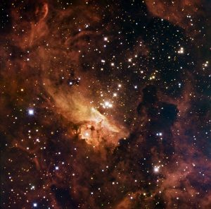 Home to some of the largest stars ever discovered, the open stellar cluster Pismis 24 blazes from the core of NGC 6357, a nebula in the constellation of Scorpius (the Scorpion). Several stars in the clusters weigh in at over 100 times the mass of the Sun, making them real monster stars. The strange shapes taken by the clouds are a result of the huge amount of blazing radiation emitted by these massive, hot stars. The gas and dust of the nebula hide huge baby stars in the nebula from telescopes observing in visible light, as well as adding to the hazy appearance of the image. This image combines observations performed through three different filters in visible light (B, V, R) with the 1.5-metre Danish telescope at the ESO La Silla Observatory in Chile.