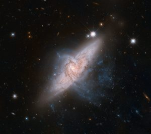 The NASA/ESA Hubble Space Telescope has produced an incredibly detailed image of a pair of overlapping galaxies called NGC 3314. While the two galaxies look as if they are in the midst of a collision, this is in fact a trick of perspective: the two are in chance alignment from our vantage point.