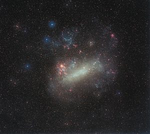 This ground-based image of the Large Magellanic Cloud was taken by the German astrophotographer Eckhard Slawik. It spans 10 x 10 degrees. Just to the left of the middle of this image the largest star-forming region in the Local Group of galaxies, 30 Doradus, is seen as a red patch. N11B itself is seen in the upper right part of the LMC.