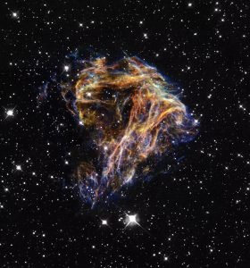 Resembling the puffs of smoke and sparks from a summer fireworksdisplay in this image from NASA/ESA Hubble Space Telescope, these delicate filaments are actually sheets of debris from a stellar explosion in a neighboring galaxy. Hubble's target was a supernova remnant within the Large Magellanic Cloud (LMC), a nearby, small companion galaxy to the Milky Way visible from the southern hemisphere. Denoted N 49, or DEM L 190, this remnant is from a massive star that died in a supernova blast whose light would have reached Earth thousands of years ago. This filamentary material will eventually be recycled into building new generations of stars in the LMC. Our own Sun and planets are constructed from similar debris of supernovae that exploded in the Milky Way billions of years ago.