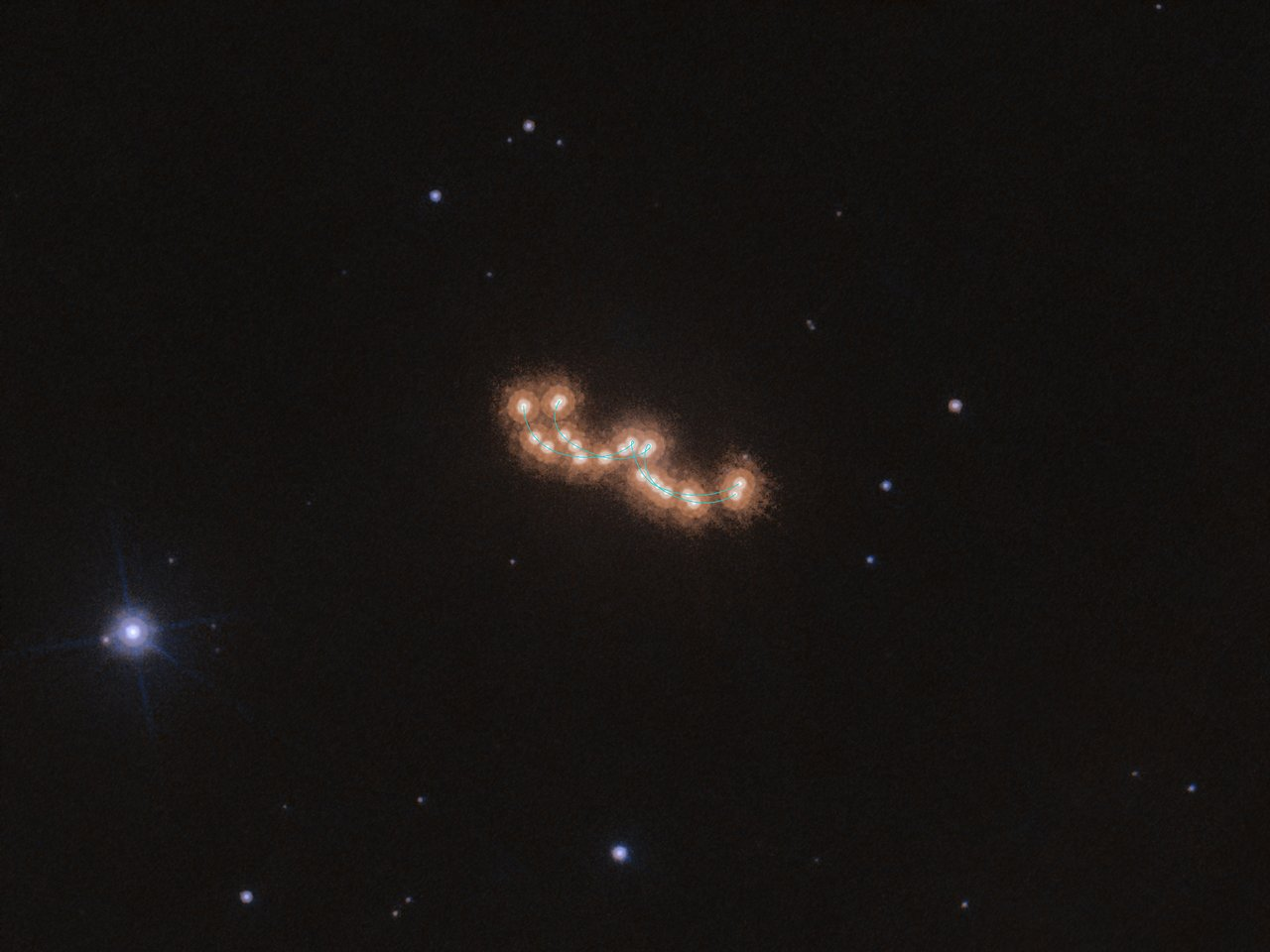 This seemingly unspectacular series of dots with varying distances between them actually shows the slow waltz of two brown dwarfs. The image is a stack of 12 images made over the course of three years with the NASA/ESA Hubble Space Telescope. Using high-precision astrometry, an Italian-led team of astronomers tracked the two components of the system as they moved both across the sky and around each other. The observed system, Luhman 16AB, is only about six light-years away and is the third closest stellar system to Earth — after the triple star system Alpha Centauri and Barnard's Star. Despite its proximity, Luhman 16AB was only discovered in 2013 by the astronomer Kevin Luhman. The two brown dwarfs that make up the system, Luhman 16A and Luhman 16B, orbit each other at a distance of only three times the distance between the Earth and the Sun, and so these observations are a showcase for Hubble's precision and high resolution. The astronomers using Hubble to study Luhman 16AB were not only interested in the waltz of the two brown dwarfs, but were also searching for a third, invisible, dancing partner. Earlier observations with ESO's Very Large Telescope indicated the presence of an exoplanet in the system. The team wanted to verify this claim by analysing the movement of the brown dwarfs in great detail over a long period of time, but the Hubble data showed that the two dwarfs are indeed dancing alone, unperturbed by a massive planetary companion. Links:  INAF press release (Italian) Video on waltzing dwarfs