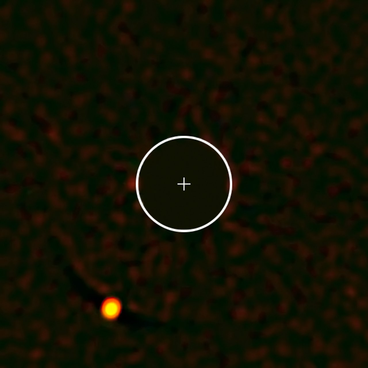 The exoplanet HIP 65426b — the first to be seen by the SPHERE instrument on ESO's Very Large Telescope. The image of the parent star has been removed from the image for clarity, and its position marked with a cross; the circle indicates the orbit of Neptune around the Sun on the same scale. The planet is clearly visible at the lower-left in this remarkable image.
