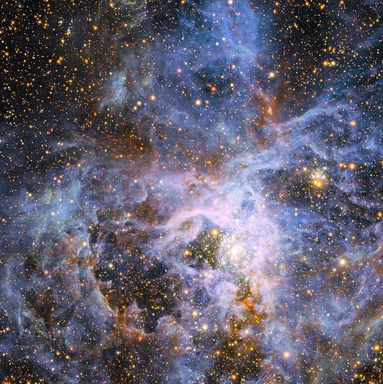 This view shows part of the very active star-forming region around the Tarantula Nebula in the Large Magellanic Cloud, a small neighbour of the Milky Way. At the exact centre lies the brilliant but isolated star VFTS 682 and to its lower right the very rich star cluster R 136. The origins of VFTS 682 are unclear — was it ejected from R 136 or did it form on its own? The star appears yellow-red in this view, which includes both visible-light and infrared images from the Wide Field Imager at the 2.2-metre MPG/ESO telescope at La Silla and the 4.1-metre infrared VISTA telescope at Paranal, because of the effects of dust.