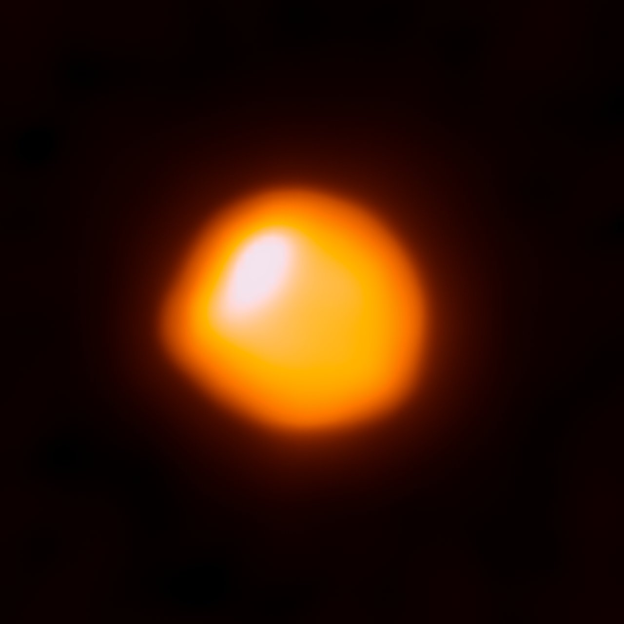 This orange blob shows the nearby star Betelgeuse, as seen by the Atacama Large Millimeter/submillimeter Array (ALMA). This is the first time that ALMA has ever observed the surface of a star and this first attempt has resulted in the highest-resolution image of Betelgeuse available. Betelgeuse is one of the largest stars currently known — with a radius around 1400 times larger than the Sun's in the millimeter continuum. About 600 light-years away in the constellation of Orion (The Hunter), the red supergiant burns brightly, causing it to have only a short life expectancy. The star is just about eight million years old, but is already on the verge of becoming a supernova. When that happens, the resulting explosion will be visible from Earth, even in broad daylight. The star has been observed in many other wavelengths, particularly in the visible, infrared, and ultraviolet. Using ESO's Very Large Telescope astronomers discovered a vast plume of gas almost as large as our Solar System. Astronomers have also found a gigantic bubble that boils away on Betelgeuse's surface. These features help to explain how the star is shedding gas and dust at tremendous rates (eso0927, eso1121). In this picture, ALMA observes the hot gas of the photosphere of Betelgeuse at sub-millimeter wavelengths — where localised increased temperatures explain why it is not symmetric. Scientifically, ALMA can help us to understand the extended atmospheres of these hot, blazing stars. Links:  Size comparison: Betelgeuse and the Sun